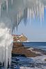 Split Rock Lighthouse framed by icicles
