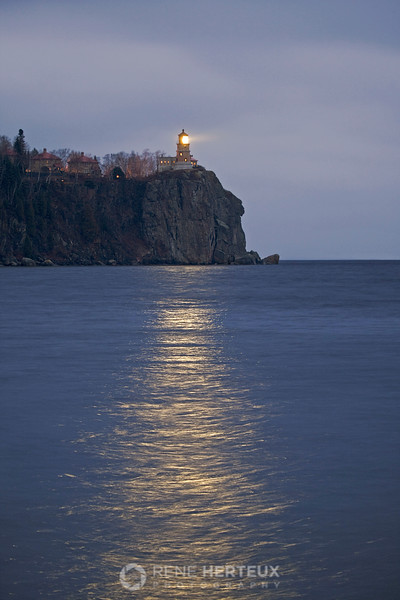 Split Rock lighthouse lit up on the anniversary of the sinking of the Edmund Fitzgerald