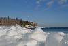 Ice boulders on pebble beach