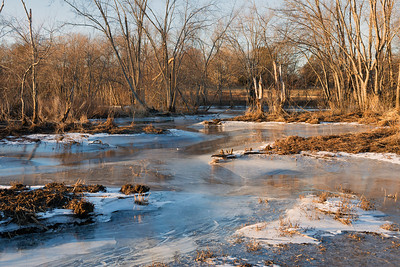 20130127. Frozen creek in Minute Man NHP.  The water has gone down after being frozen so the ice forms a concave surface.