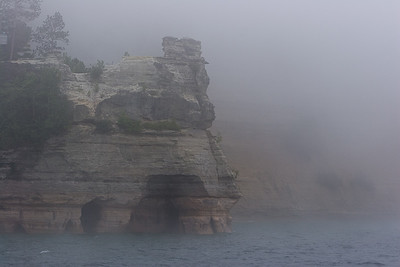1059   Miners Castle, MI Knowing that there was a 2nd turret that fell off in 2006 & seeing the cave at the bottom might help explain its name.  The fog got worse to the point the captain of the tour boat aborted the cruise.  The weather was very cold & windy.