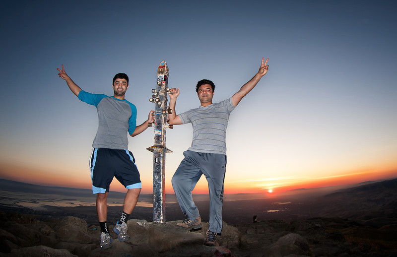 Asees and Zahid at Mission Peak's summit marker shot with the fisheye lens and the on-camera flash.