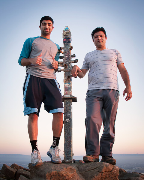 Asees and Zahid at Mission Peak's summit marker.