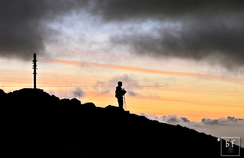 A hiker surveys the view from Mission Peak.