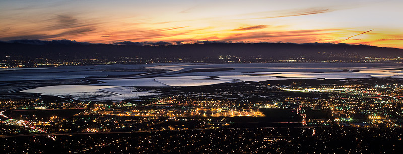 The sunset lit up the sky and the lights below lit up the East Bay.