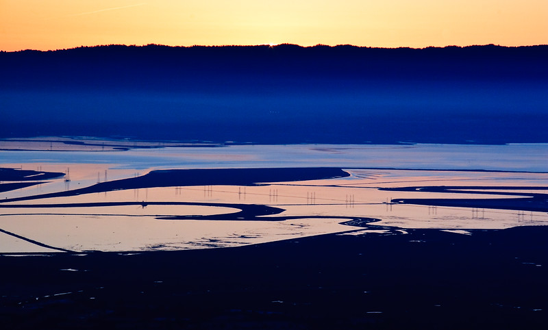The sun fell just below the horizon creating this effect of a yellow-orange sky and blue haze over the Bay.