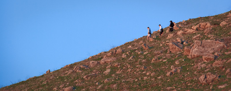 Hikers descend Mission Peak.