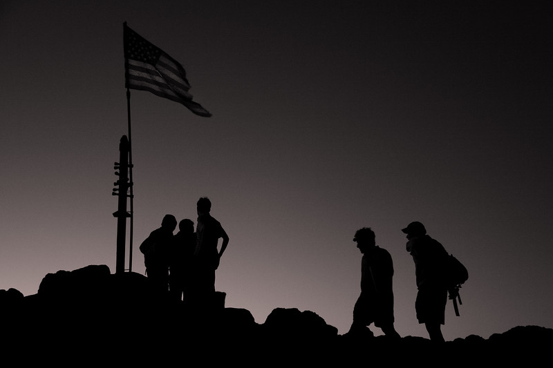 Hikers congregate at Mission Peak's summit. I discovered that someone had attached the American flag to the peak's marker.