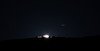 The moon finally peeks over the summit.