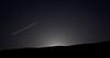 The moon glows just below Mission Peak's summit. A thirteen-second exposure.