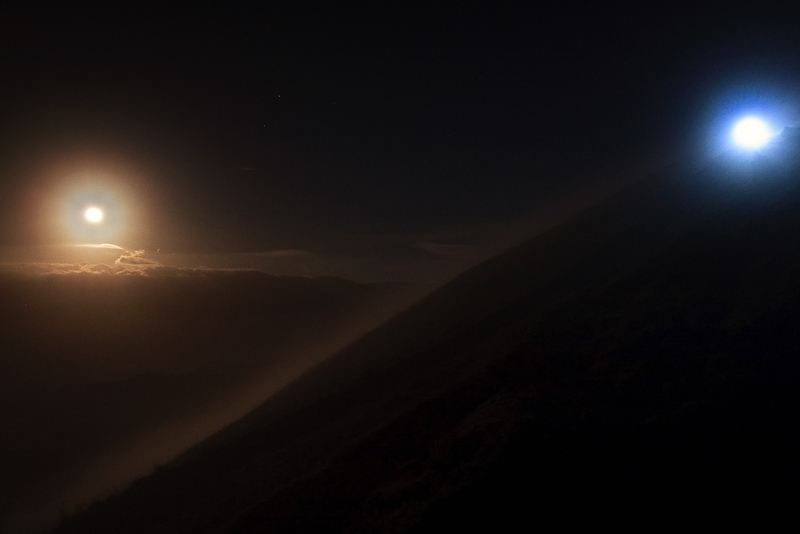 While this photo looks like I was on another planet with two moons like Mars, I assure you I wasn't! ;-) The full moon at perigee is rising above the fog on the left. And on the right...