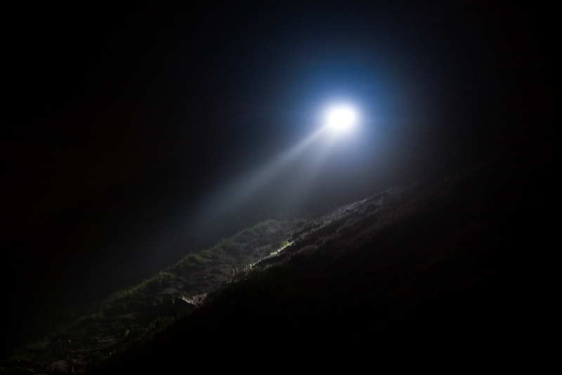 ...is a hiker decending the peak. Even with the full moon and a flashlight I was still having trouble seeing the trail due to the thickening fog. I felt bad for the people who found themselves hiking without a light. I offered to help a hiker down the rocky part of the trail, but he declined. Hope he made it down okay.
