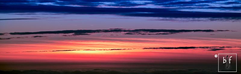 The sun illuminated the clouds at sunset.