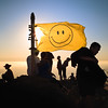 Hikers congregate around the smiley face.