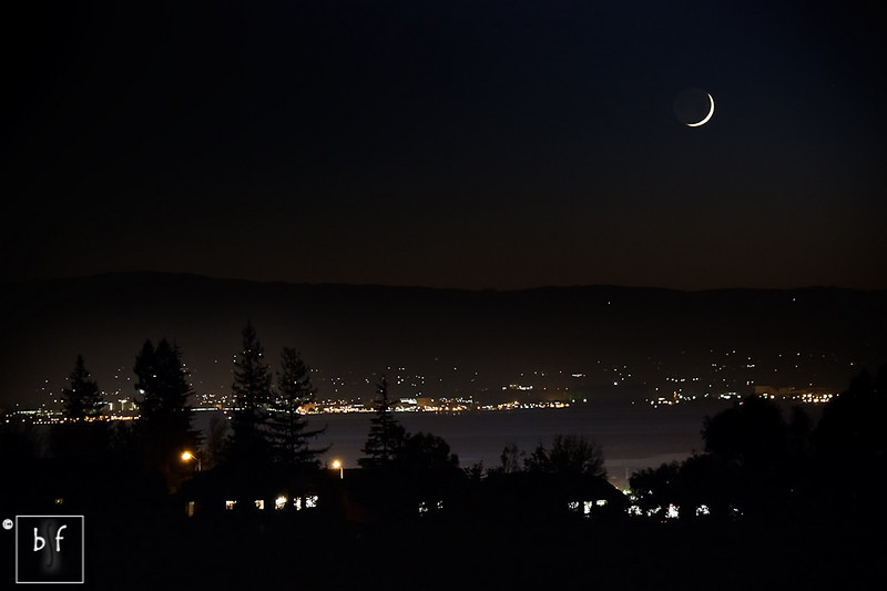 With the sun fully set, the waxing crescent moon shines brightly.