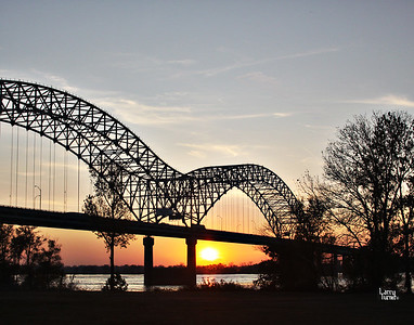 The bridge at Memphis, TN on the Mississippi River at sunset.