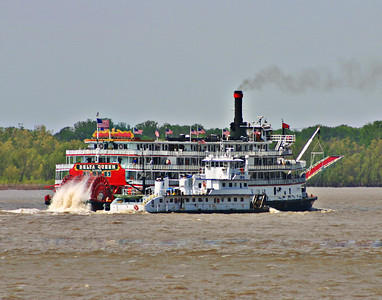 The last voyage of Delta Queen  heading up stream at Memphis, TN on the Mississippi River.