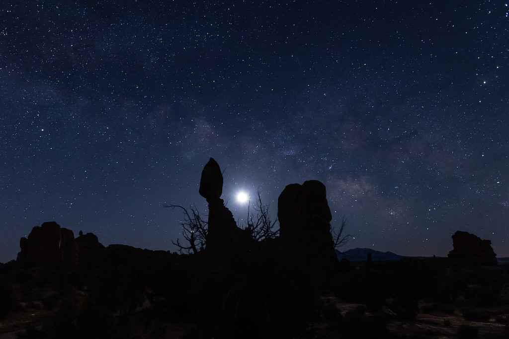 The Milky Way and Balanced Rock in Arches National Park. The moon is just to the right of the Balanced Rock.