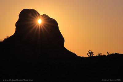 sun shining through the eye of the mojave in the Mojave Desert, California