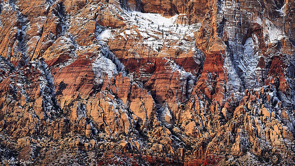 Red Rock Powdered Sugar  Red Rock Canyon Conservation Area - Las Vegas, Nevada  This is a 3 pano stich of Mt. Wilson 3,000ft vertical rock face.  The tiny little patch of trees seen here is called Sherwood Forest by the local climbers and serves as the easiest identification spot along the way.  This is just an extraction of all the beautiful scenery that surrounds this intimite view.  It's hardley noticeable at this resolution but crisp as can be in a large print.
