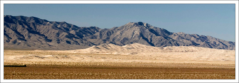 Wide view of the highest portion of the Kelso Dunes. This was taken facing southwest about 1.9 miles north of the junction of Kelbaker and Cima Roads. The large dunes are approximately 9 miles away while the small dune field to the left is about 4 miles away. The Granite Mountains are in the background. The peak just to the right of center is Silver Peak and is 6762 feet high.