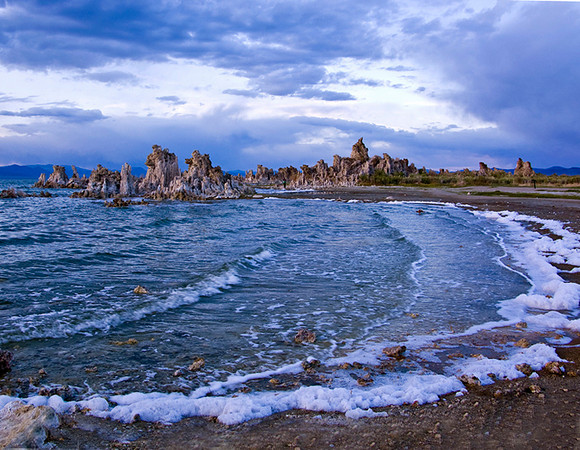 Sunset at Mono Lake.   Mono Lake is a salt lake and not sure why there was foam as it wasn't there the next night.  It was windy and the water was very choppy.