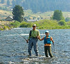 Wading the Madison River by Slide Inn