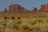 Two hogans (pronounced HoeGAHN'), a traditional Navaho dwelling made of logs and mud. Several hundred Navaho live right in the middle of the heart of Monument Valley. These structures, however, are rented out to visitors.
