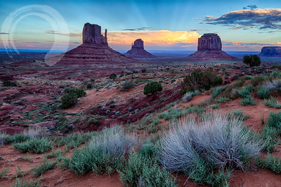I headed down to Monument Valley hoping to catch the alignment of the Mitten shadow again.  The forecast was for rain, so I thought I might be able to catch some good clouds at sunset.  All of the canyons in Utah had flash-flooded on the day I started out, and it's fairly difficult to find things to do in this part of Utah when all the dirt/clay roads have been saturated and become slick.  On the up side, it makes the colors vibrant, reminiscent of the psilocybin paintings of the SW.