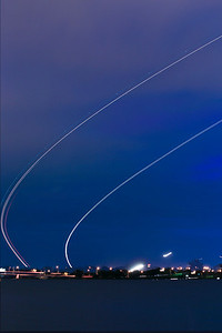 Interesting arcs in the sky from planes taking off from Reagan National Airport. These are multiple images with each image about 30 second exposure.