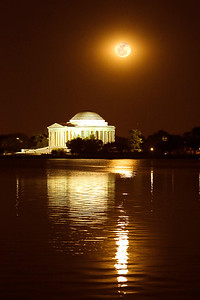 Full moon rises high over the Thomas Jefferson Memorial on the Tidal Basin in Washington D.C. on Memorial Day weekend.