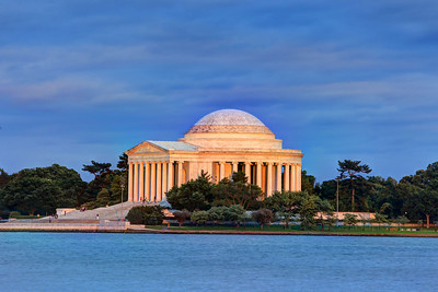 The Thomas Jefferson Memorial from across the Tidal Basin bathed in the glow of the setting sun light