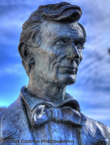 February 12th, Lincoln's Birthday...John McClarey, an internationally known Lincoln sculptor from Decatur, Illinois, was commissioned to create this exceptional bronze statue called Lincoln Draws the Line, to commemorate one of Lincoln's most powerful speeches on his opposition to the expansion of slavery, given on October 16, 1854 on the grounds of the Peoria courthouse. On October 14, 2001, this statue was placed near the actual location of the speech.
