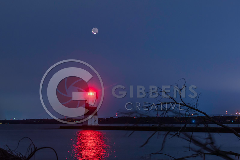 Moon rising over North Pier Lighthouse Presque Isle Pa
