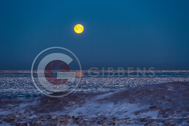 Ice moon setting on Presque Isle State Park