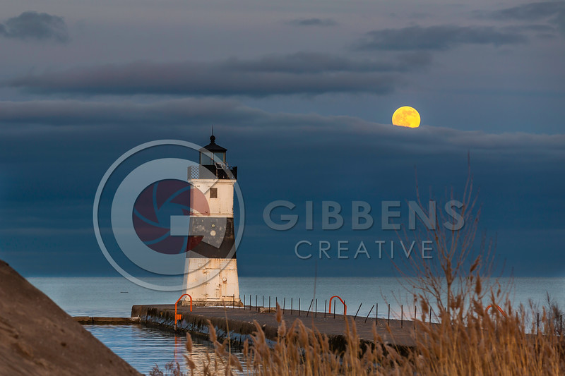 Full moon rising over North Pier Light House Presque Isle Pa