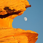 """""""Eating the Moon""""   I captured this during my last visit to the Valley of Fire, one of my favorite places to shoot.  I placed the moon during the moonrise in the mouth of the orange rocks here.  Moons always provide a different element to an already beautiful picture.  My other Valley of Fire images can be seen here:  <a href=""""http://www.jharrisonphoto.com/Landscapes/Rockscapes-in-the-Valley-of"""">http://www.jharrisonphoto.com/Landscapes/Rockscapes-in-the-Valley-of</a>"""