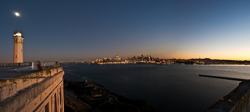 "Moon over Alcatraz.  San Francisco skyline and panorama at sunset.   I went on a private shoot on Alcatraz where we rented out the entire island!  40 photographers had it to ourselves.  It was great - normally there are SO many tourists it isn't possible to get a clear shot and it is WAY too crowded.  This fall evening also happened to be a nice warm 75 degree night!   The lead park ranger took us up on the roof of Alcatraz!!  Some of the other park rangers hadn't even been up there.  The view was amazing!!  This is the panorama view of San Francisco at Dusk and the moon coming up over the Alcatraz Lighthouse.   Such a fantastic place to be!  More Alcatraz images can be seen here: <a href=""http://www.jharrisonphoto.com/Landscapes/Alcatraz-San-Francisco-Night/3758304_TaDSP"">http://www.jharrisonphoto.com/Landscapes/Alcatraz-San-Francisco-Night/3758304_TaDSP</a>"