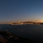 """Moon over Alcatraz.  San Francisco skyline and panorama at sunset.   I went on a private shoot on Alcatraz where we rented out the entire island!  40 photographers had it to ourselves.  It was great - normally there are SO many tourists it isn't possible to get a clear shot and it is WAY too crowded.  This fall evening also happened to be a nice warm 75 degree night!   The lead park ranger took us up on the roof of Alcatraz!!  Some of the other park rangers hadn't even been up there.  The view was amazing!!  This is the panorama view of San Francisco at Dusk and the moon coming up over the Alcatraz Lighthouse.   Such a fantastic place to be!  More Alcatraz images can be seen here: <a href=""""http://www.jharrisonphoto.com/Landscapes/Alcatraz-San-Francisco-Night/3758304_TaDSP"""">http://www.jharrisonphoto.com/Landscapes/Alcatraz-San-Francisco-Night/3758304_TaDSP</a>"""