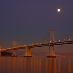 """""""Moonbeam"""" San Francisco-Oakland Bay Bridge and almost full moon. Yerba Buena Island is in the picture."""
