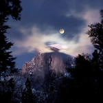 "Fullmoon over Half Dome.  Yosemite Winter 2007.  This was my 'consolation' shot while trying to capture my ""Nature's Firefalls"" rare image of Horsetail falls at sunset.   I wish that I could say that I had fully researched this shot and was ready for it.  Instead, I was coming back from another failed attempt to capture my Nature's Firefalls image.  When I came around the corner, the moon was sitting there!!  I stopped my car, setup my tripod in the middle of the road (please don't tell the park rangers I did that as it isn't a good idea!)  I captured 4 shots before the moon and Half Dome were totally obscured by the clouds!  I was pretty lucky to capture this - but that is part of photography.  See my Nature's Firefalls image here:  <a href=""http://www.jharrisonphoto.com/gallery/2747559_ghkMc/1/281579766_t4hmN/Medium"">http://www.jharrisonphoto.com/gallery/2747559_ghkMc/1/281579766_t4hmN/Medium</a>     My portfolio of images can be seen here:  <a href=""http://www.smugmug.com/gallery/2747559_ghkMc"">http://www.smugmug.com/gallery/2747559_ghkMc</a>"