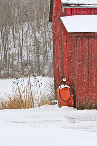 February 14, 2014. Old red barn and gas tank in snow. Morgan County, WV.