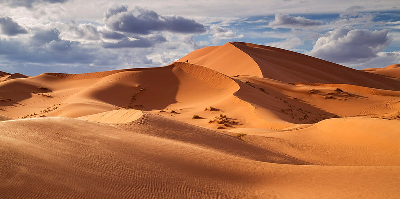The dunes of Erg Chebbi reach a height of up to 150 meters. The lone traveler give you a sense of scale in this landscape.