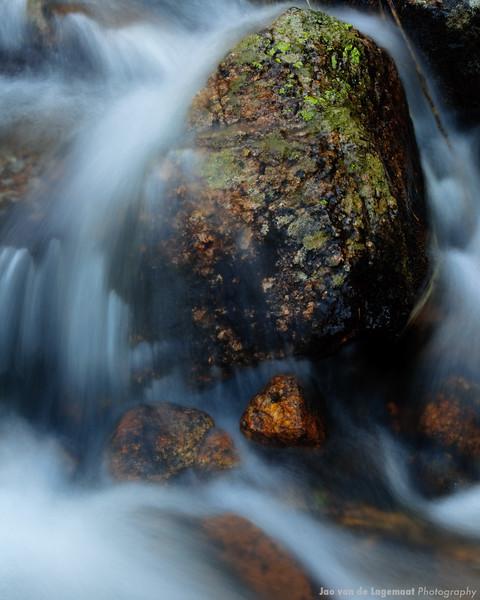 Mossy rock in waterfall