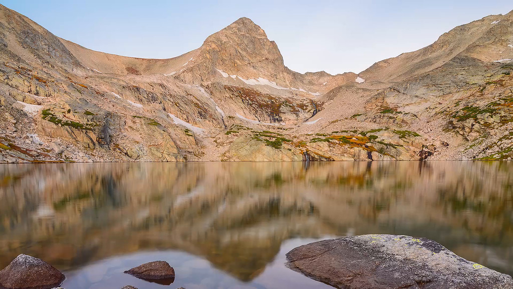 Sunrise on Mount Toll is reflected in Blue Lake