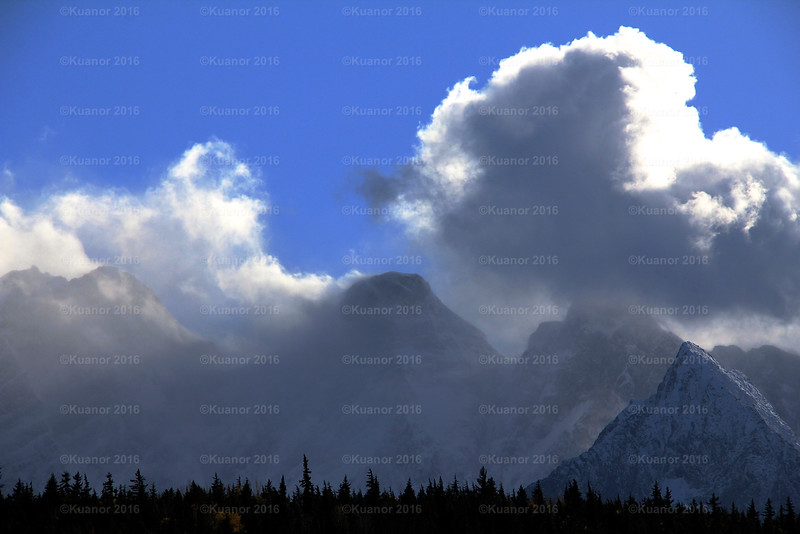 Mountain Breath<br /> Three of the sisterhood exhale clouds of cold: Seven Sisters National park, Northern BC.