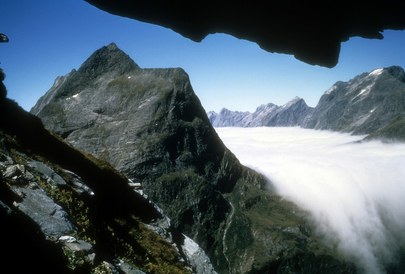 Moist ocean air spills over a divide on the Milford Track New Zealand