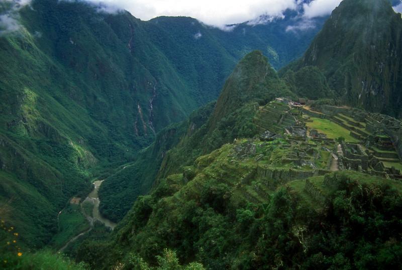 Machu Pichu sits high above a river gorge