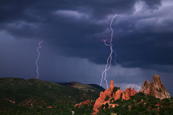 I'm well known for my driving abilities, and I had to use them all in order to get set up before this storm had passed by.  The storm was moving over Pikes Peak, and as I drove through Garden of the Gods park I could see that it was moving a bit north, so I pulled into the south parking lot and came away with 3 shots with lightning strikes, this one being the best.