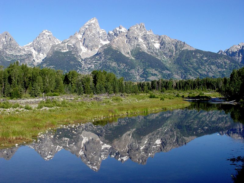 Early morning July reflections of Grand Tetons in Snake River at Schwabacher Landing  This photo was awarded a First Place Award in Photography Exhibit at the Walla Walla Frontier Days Fair and Rodeo.